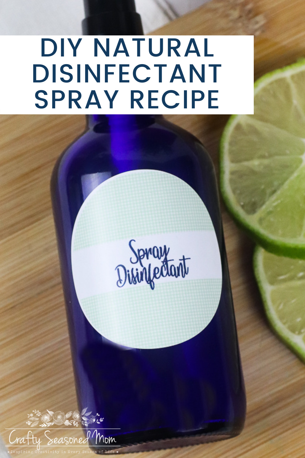 blue spray bottle next to sliced limes for DIY Natural Disinfectant Spray Recipe
