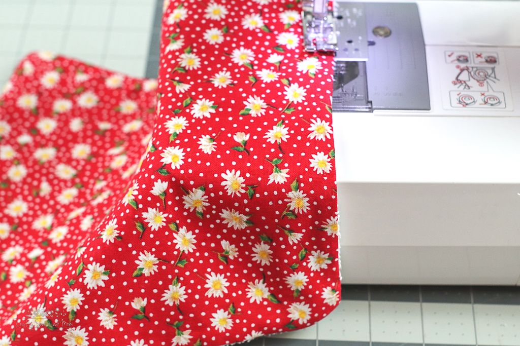 red floral fabric on a sewing machine for How To Make Reusable Fabric Paper Towels