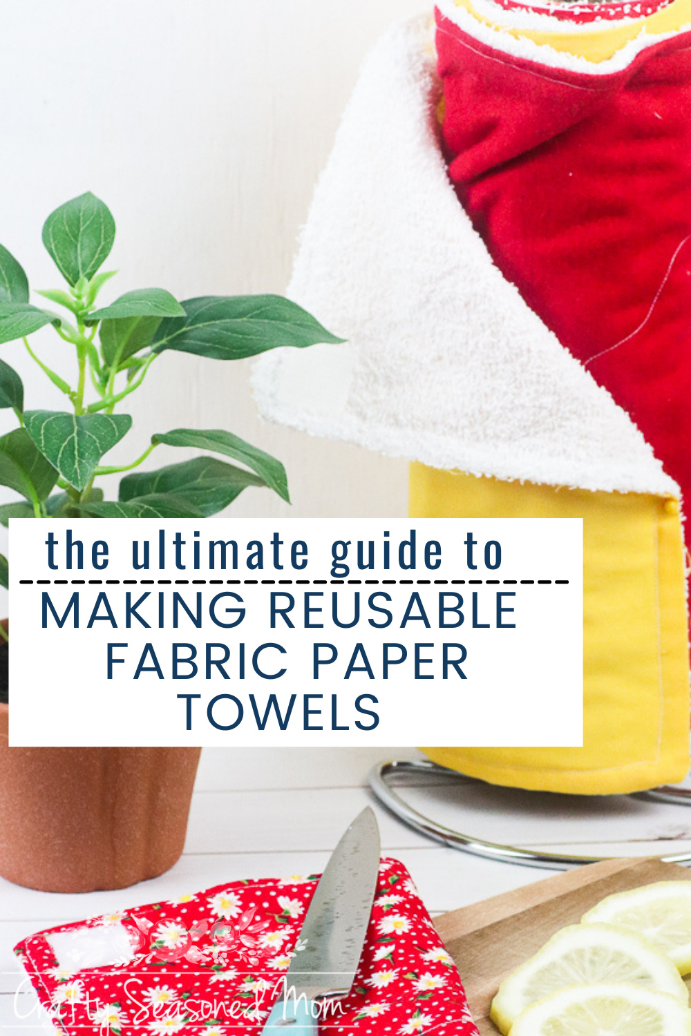 How To Make Reusable Fabric Paper Towels on a holder next to a plant on a white table
